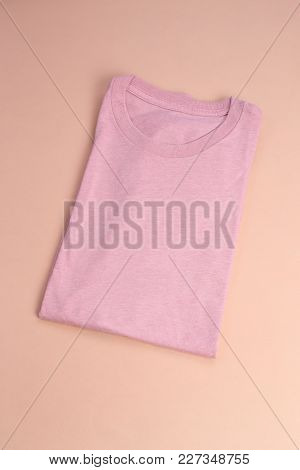 Foled Pink Pastel T-shirt On Pastel Background