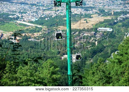 5th July 2014, Dali, China - Cable Cars Carry People To The Summit Of Mount Cangshan In Dali, Yunnan