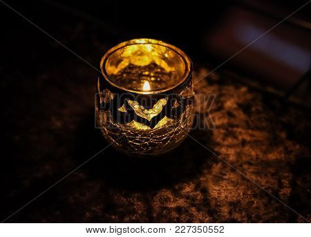 Close Up Of A Small Candle In An Ornate Glass
