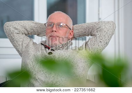 Middle-aged Man Relaxing A Moment In The Sofa