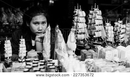 KO CHANG, THAILAND - FEB 18, 2018: Seller ofSouvenir of Bang Bao fishing village, which consists of houses on stilts built into the sea. Ko Chang consisting of 8 villages with 5,356 inha