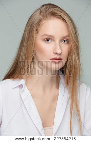 I Am Pretty. The Beautiful Female Face. The Young Serious Happy Woman With Perfect And Clean Skin Of