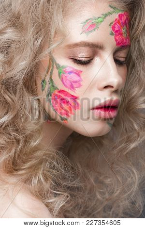 Beautiful Blond Girl With Tresses And A Floral Pattern On The Face. Beauty Flowers. Portrait Shot In