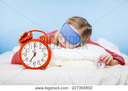 Sleeping Young Woman Wearing Cute Pink Pajamas Holding Big Red Old Fashioned Clock Showing Sleep Tim