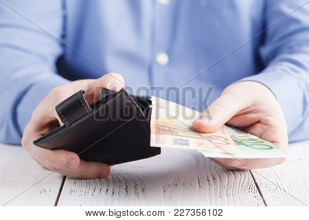 Man Gets Money From The Wallet In Hand