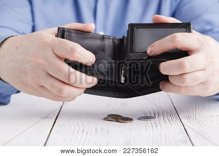 Empty Wallet In Man Hands Close Up