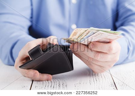 Man Hands Taking Out Money From Wallet