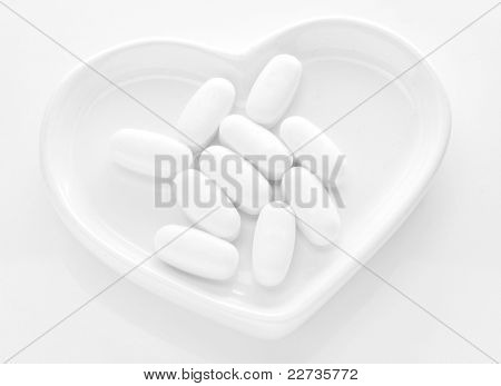 The pills on a white hearth.
