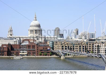 London, England - May 24, 2009: Tourists Crossing The Millennium Bridge To Visit The St Paul Cathedr
