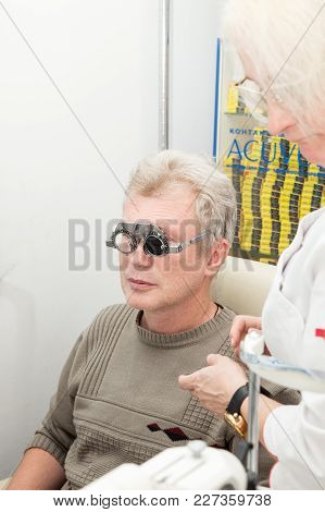 Saint Petersburg, Russia - February 13, 2018: A Mature Man Visits An Ophthalmologist. Eyesight Check
