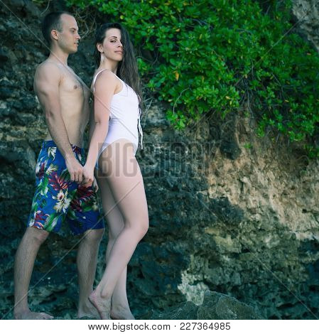 Pretty Couple At The Beach, Sea View. Traveling At Bali. Honeymoon Summer Travel At Indonesia.