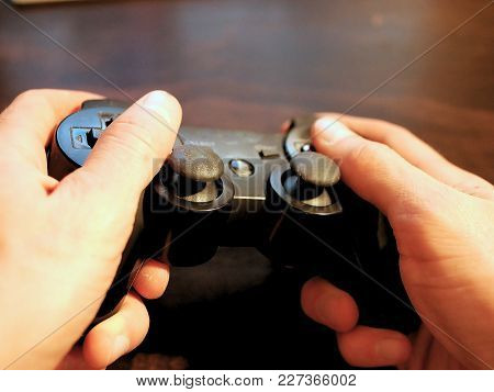 Video Game Console Controller For Gaming Held In Gamers Hands.