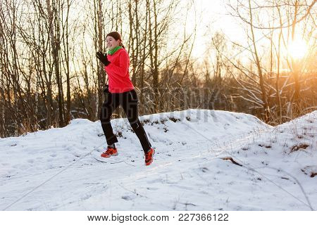 Photo Of Happy Sportswoman On Morning Run In Winter Forest