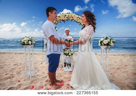 Wedding Couple Just Married At The Beach, Bali. Wedding Ceremony