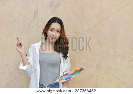 Concept Artist Beautiful Girl. Beautiful Women Are Creating Art. Beautiful Woman Is Painting Happily