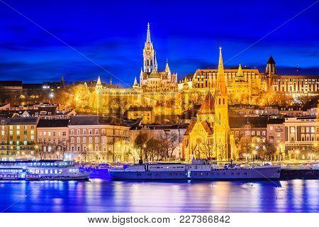 Budapest, Hungary. Matyas Church, Buda Hill And Fishermen Bastion, Twilight Hour.