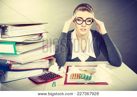 Fatigue And Pain Concept. Young Elegant Businesswoman With Lot Of Pills For Diseases And Aches. Tire
