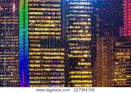 Close Up Colourful Modern High Rise Building View From The Kowloon At Night Time In Hong Kong.
