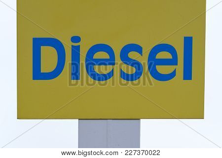 Blue And Gold Diesel Sign In White