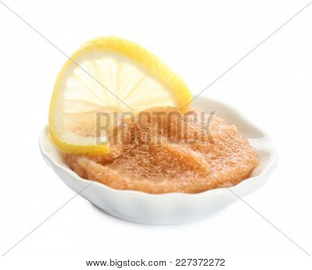 Plate with delicious cod caviar on white background