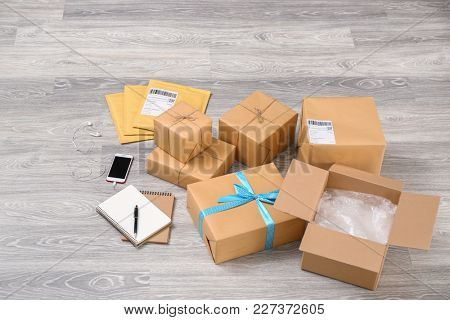 Preparing parcels for shipment to customer on floor