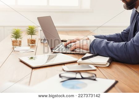 Unrecognizable Businessman Working At Laptop In Modern Office, Hands Typing On Computer Keyboard, Si