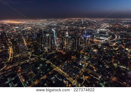 Los Angeles, California, USA - February 11, 2018:  Night aerial view of urban downtown towers and streets in Southern California.