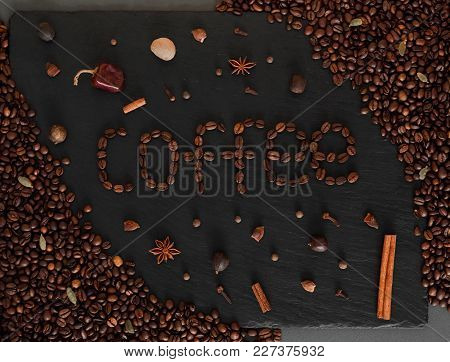 Dark Background With Coffeeped Phrase Coffe. Black Texturised Background With Coffee Beans And Spice