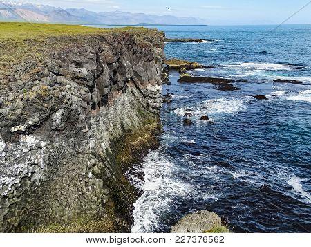 Cliffs Washed By Waves Near Gatklettur Arch Rock In Snaefellsjokull Iceland