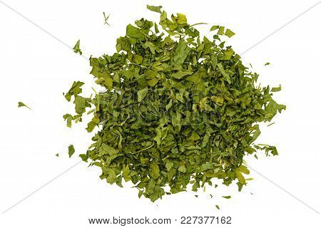 Handful Of Dried Green Parsley On A White Background