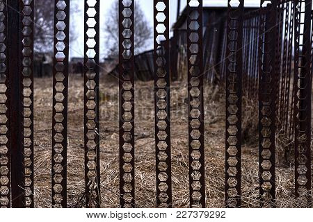 The Metal Fence Around The Old House