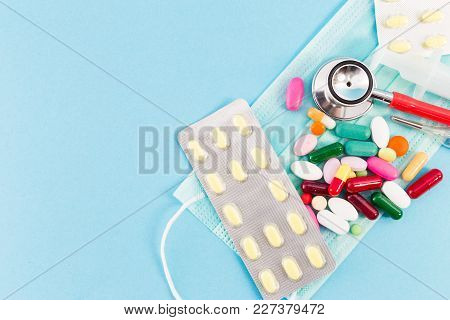 Capsules Stethoscope And Surgical Mask As Medical Template.
