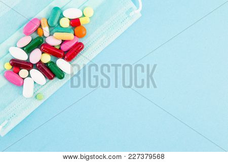 Pills Or Capsules On Surgical Protective Mask.