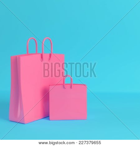 Pink Shopping Bags On Bright Blue Background In Pastel Colors. Minimalism Concept. 3d Render