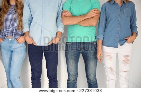 Group of young people on light background. Unity concept