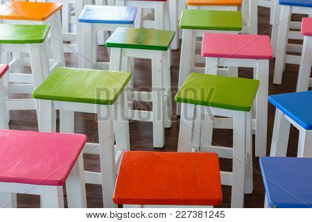 Colourful A Wooden Chairs On The Floor