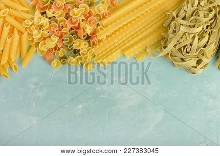 Beautiful Composition Of Pasta With Space For Text, Copy Space. Penne, Mafalde, Tagliatelle, Spaghet