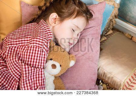 Adorable Little Child Sleeping With Teddy Bear