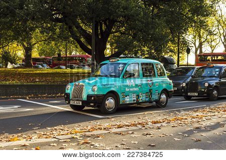London, England - October 25 2017: Colorful London Taxi On The Street. Sunny Day In London. London,