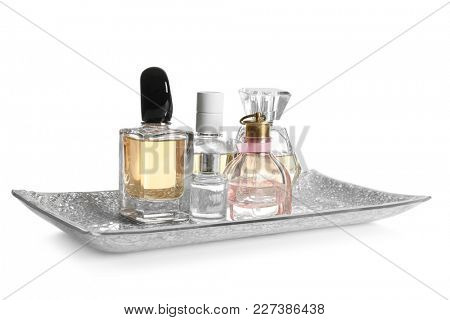 Tray with perfume bottles on white background