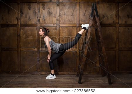Active Girl Training Ith Wooden Ladder. Sport Concept.
