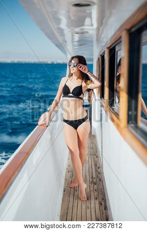 Pretty Young Slim Sexy Brunette Woman In Sunglasses And Black Stylish Bikini On Private Speed-boat Y