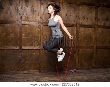 Active Timespending. Girl Jumping On Rope Indoor