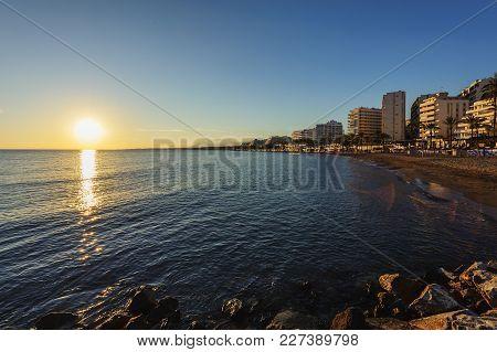 Sunset Coastline At Costa Del Sol Beach In Marbella Town, Andalusia, Spain