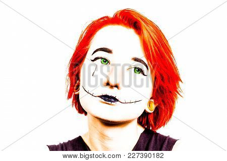 Portrait. Teenage Girl With Bright Red Hair At The White Wall. On The Face Of The Girl Makeup.