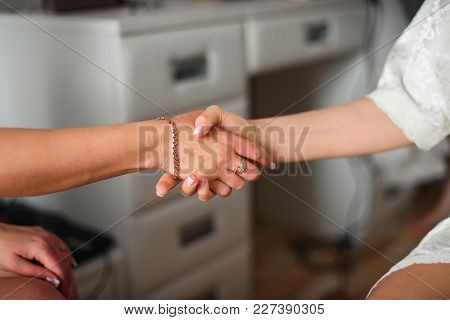 Mom Keeps Daughter's Hand In Wedding Day