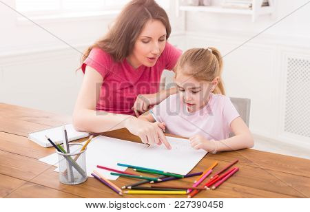 Mother Drawing With Her Daughter At Home. Motherhood, Joint Activities And Interests, Maternal Warmt