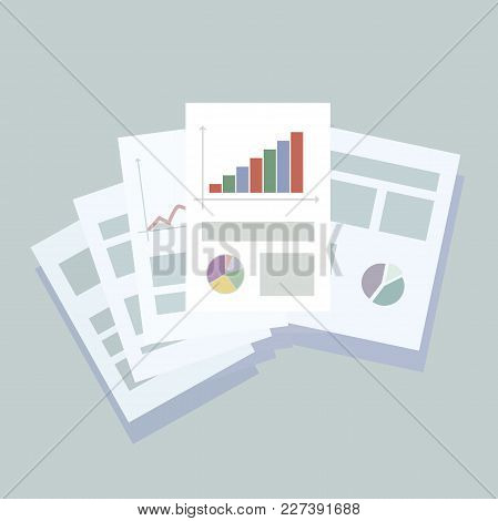 Composition Of Office Business Sheets Of Paper With Graphs And Articles On A Light Blue Background