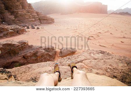 Jordan National Park Wadi Rum Desert. Beautiful View And Panoramatic Picture Of Man Legs And Outdoor