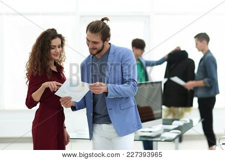 fashion designers discussing new ideas